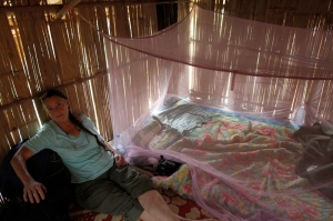 Gail in bamboo hut in hill tribe village, northern Thailand