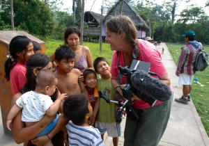 Gail showing video to children of remote Amazon village, Peru