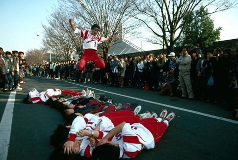 Roller skaters jump over teammates, Tokyo, Japan