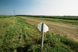 Bent stop sign at crossroads, Mississippi Delta