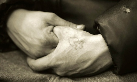 Hands of man in homeless shelter, New York City